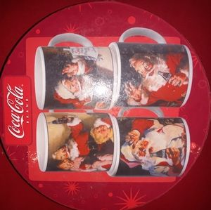 Coca cola Christmas mugs.